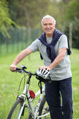 Man riding his bike — Stock Photo