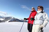 Senior couple skiing — Stock Photo
