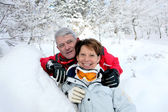 Senior couple in snowy landscape — Stock Photo