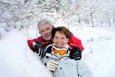 Senior couple in snowy landscape — Stock Photo