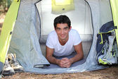 Teenager in a tent — Stock Photo