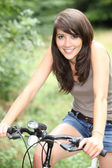 Splendid-looking brunette on her bike — Stock Photo