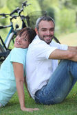 Couple having a bike ride in the country — Stock Photo