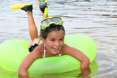 Young girl learning to snorkel — Stock Photo