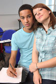 Girl and boy in classroom — Stock Photo