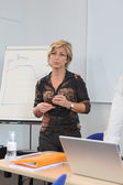 Woman at a whiteboard in a presentation — Stock Photo
