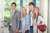 Students and teacher at school — Stock Photo