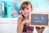 A schoolgirl showing a slate — Stock Photo