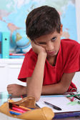 Schoolboy visibly bored — Stock Photo
