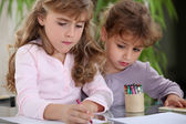 Little girls drawing with crayons — Stock Photo