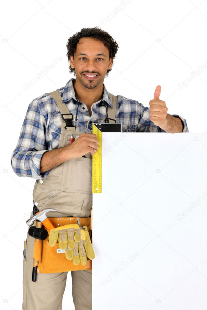 Builder stood with blank advertising panel — Stock Photo #7903396