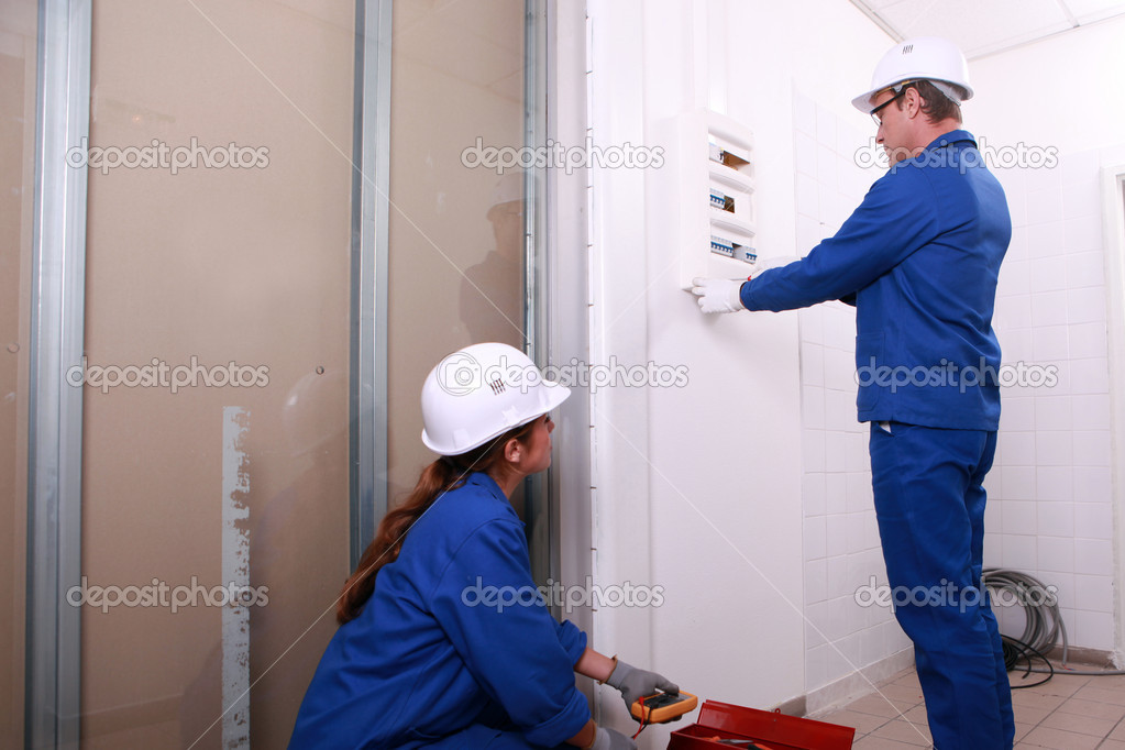 Electricians installing a distribution board — Stock Photo #7904048