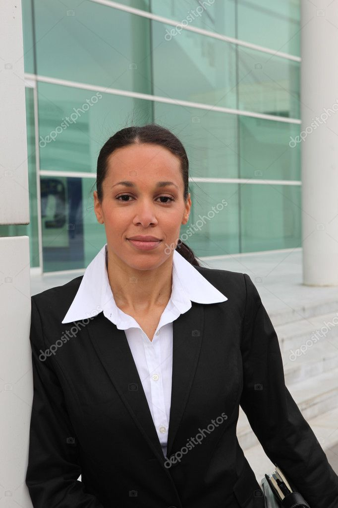 Executive standing in front of a glass building — Stock Photo #7905379