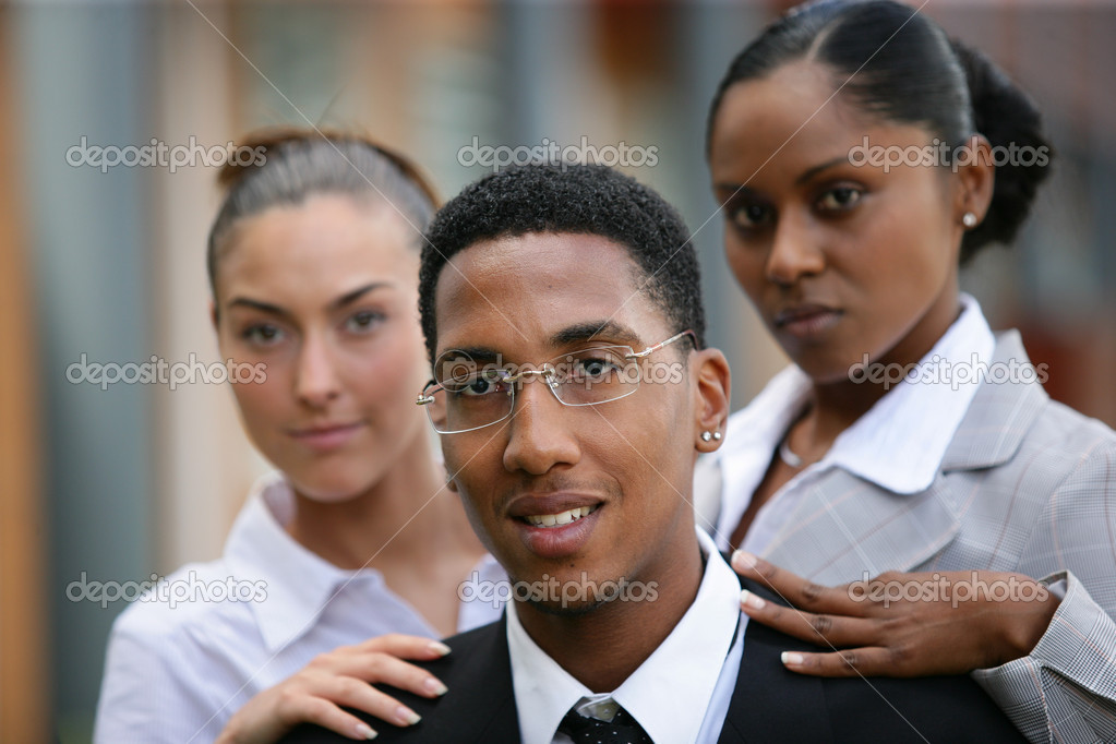 Women touching the shoulder of a man — Stock Photo #7905412