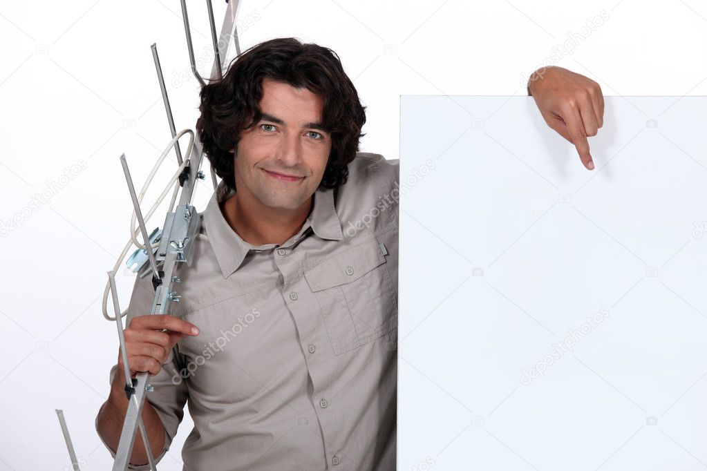 Man with a blank poster and an antenna — Stock Photo #7906077