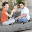 Stock Photo: Couple drinking champagne after house move
