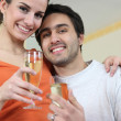 Stock Photo: Couple drinking celebratory drink
