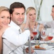 Stock Photo: Dinner party discussions