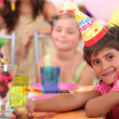 Stock Photo: Portrait of a little boy at a birthday party