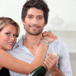 Couple with bottle of champagne - Photo