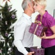 Father and adult daughter exchanging Christmas gifts — Stock Photo