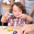 Kid playing with toy cars — Stock Photo