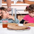 Children eating pancakes — Stock Photo
