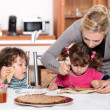 Kids eating pancakes for breakfast — Stock Photo