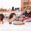Stock Photo: Young children eating crepes