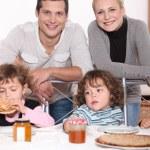 Family enjoying crepes. — Stock Photo