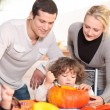 Family carving a pumpkin — Stock Photo
