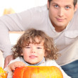 Young man, kid and pumpkin - Stock Photo