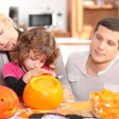 Stock Photo: Family carving pumpkins
