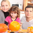 Stock Photo: Happy family ready for Halloween