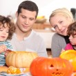 Stock Photo: Two parents and their two children celebrating Halloween