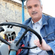 Farmer driving tractor — Stock Photo