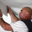 Tradesman installing drywall — Stock Photo #7911128