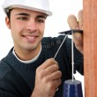 Builder inspecting wall — Stock Photo #7911161