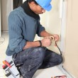 Electrician taping a wire — 图库照片