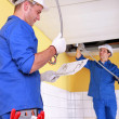 Electricians installing electrical cabling — Stock Photo #7911427