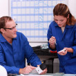 Two electrical workers ordering replacement part — Stock Photo