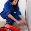 Female apprentice plumber - Stock Photo
