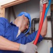 Stock Photo: Skilled technicirepairing canalizations