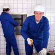 Plumbers installing water pipes — Foto de Stock