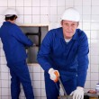 Plumbers installing water pipes — Stock Photo