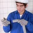 Young plumber with plastic pipe — Stock Photo #7912369