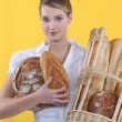 Stock Photo: Baker displaying her bread