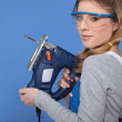 Female worker with a jigsaw — Stock Photo