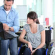 Young woman disabled with co-worker — Foto Stock