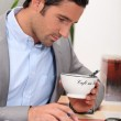 Man working and holding a cup — Stock Photo #7914454
